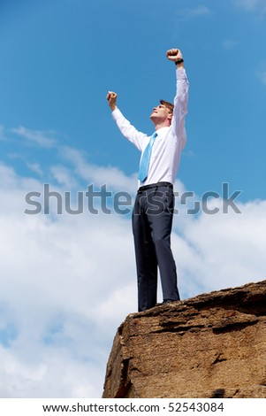 Standing at the top of a rocky cliff arms outstretched achieveme Stock photo © lovleah