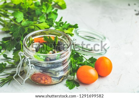 Preserved marinated sea fish in glass jar on gray concrete table stock photo © artsvitlyna