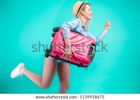 portrait of curious businesswoman holding suitcase and walking t Stock photo © feedough