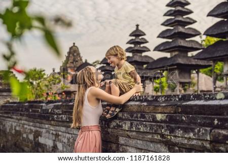 Mom and son tourists in Traditional balinese hindu Temple Taman Ayun in Mengwi. Bali, Indonesia Trav Stock photo © galitskaya