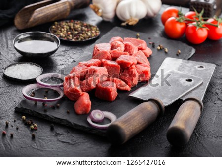 Stock photo: Raw lean diced casserole beef pork steak with vintage meat hatchet and knife and fork on wooden back