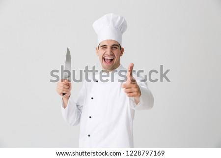 Tânăr bucătar-şef izolat alb Imagine de stoc © deandrobot