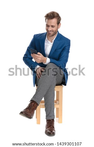 seated attractive man texting on mobile phone with legs crossed Stock photo © feedough
