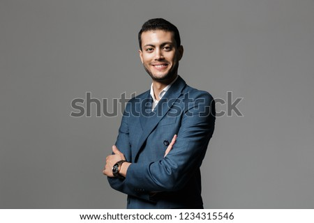 image of optimistic arabic businessman 30s in formal suit lookin stock photo © deandrobot