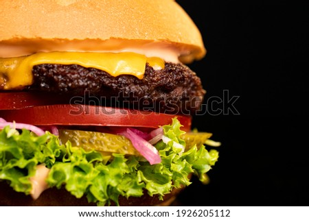 Big burger with cutlet of beef meat, melted cheese, leaf of lettuce and tomato isolated on white bac stockfoto © Lady-Luck