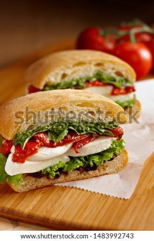 Сток-фото: Italian Caprese sandwiches with fresh tomatoes, mozzarella cheese