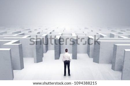 Stock photo: Businessman choosing between entrances in a middle of a dark maze