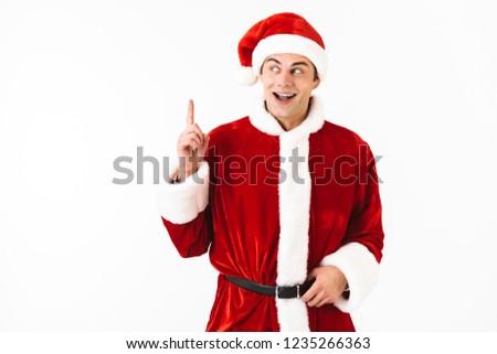 Portret opgewonden man 30s kerstman kostuum Stockfoto © deandrobot