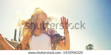 Cute blonde hair girl in a long winded dress, walking in blooming fruit garden. Stock photo © ElenaBatkova