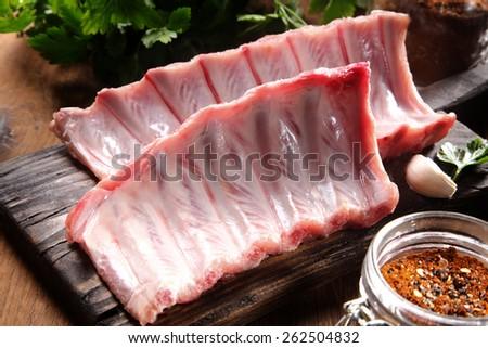 Fresh raw pork ribs on chopping board and vintage meat hatchets on black stone background. Fresh tom Stock photo © DenisMArt