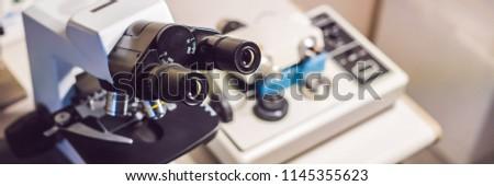 precision micrometer grinder polishing machine with an optical microscope standing by BANNER, long f Stock photo © galitskaya