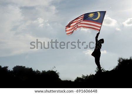 Boy travels in malaysia with malaysia flag celebrating the Malaysia independence day and Malaysia da Stock photo © galitskaya