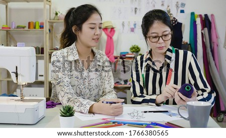 Two young dressmaker or designer colleagues working as fashion d Stock photo © Freedomz