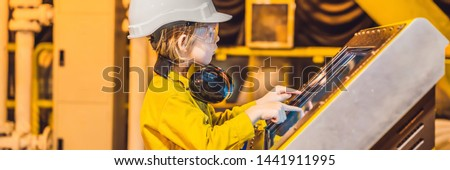 Boy operator recording operation of oil and gas process at oil and rig plant, offshore oil and gas i Stock photo © galitskaya
