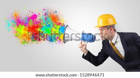 Fiatal építész kiabál megafon színes csobbanás Stock fotó © ra2studio