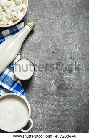 Stock photo: Fresh dairy products on white marble background. Glass of milk, bowl of flour, sour cream and cottag