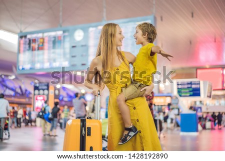 Family at airport before flight. Mother and son waiting to board at departure gate of modern interna Stock photo © galitskaya