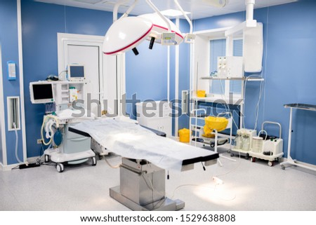 operation table with large lamps above inside contemporary surgery room stock photo © pressmaster