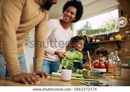 Low angle view of African American mother and daughter baking cookies in kitchen at home Stock photo © wavebreak_media