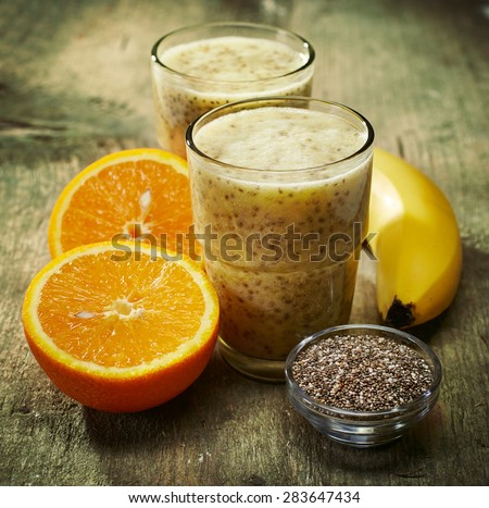 Glass of orange fruit smoothie juice with chia seeds for diet de Stock photo © Anneleven