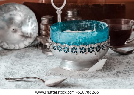 Glass jar of natural white refined sugar with silver spoon on light table background. Stock photo © DenisMArt