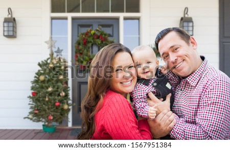 Happy Young Family On Front Porch of House With Christmas Decora Stock photo © feverpitch