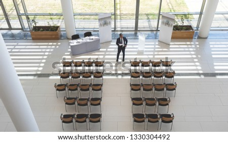 High angle view of businessman practising speech in empty conference room in office Stock photo © wavebreak_media