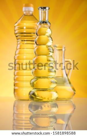 Rapeseed oil, sunflower oil, olive oil on sunburst orange backgr Stock photo © JanPietruszka