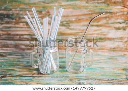 Steel drinking vs disposable straws on painted wooden background. Zero waste concept Stock photo © galitskaya