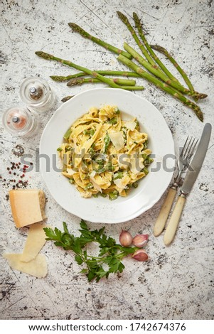 Tagliatelle pasta with ricotta cheese sauce and asparagus served on a black iron pan Stock photo © dash