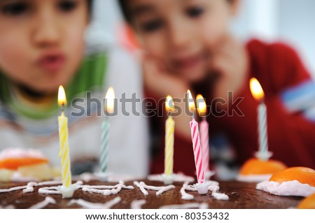 Time to blow out the candles at a child's birthday party. 6 year old boy blows out candles on a cake Stock photo © galitskaya