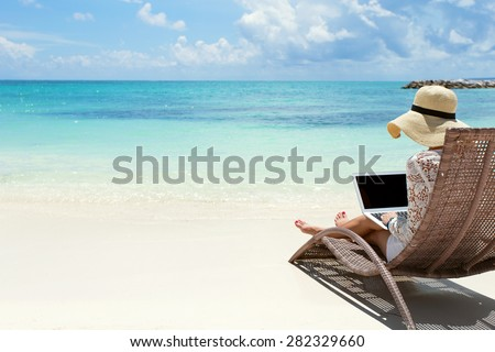 Young woman with laptop on a deck chair at the tropical beach. V Stock photo © moses