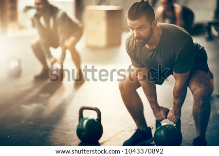 Fitness man training at gym working out Stock photo © Maridav