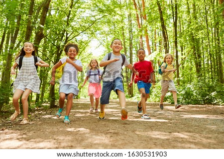 group of happy kids at summer camp or school running or racing Stock photo © godfer