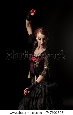 young woman dancing flamenco with castanets isolated on white Stock photo © artjazz