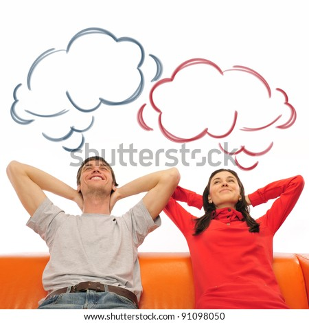 smiling beautiful couple sitting on a sofa and dreaming about ne stock photo © hasloo