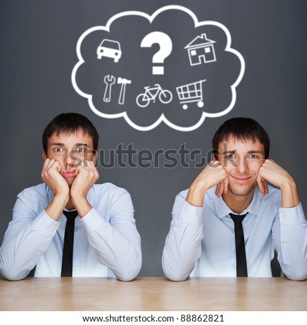 Image of two young similar men thinking of their plans sitting t Stock photo © HASLOO