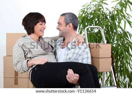 Man  carrying his partner over the threshold of their new home Stock photo © photography33
