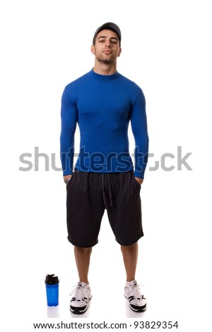 athletic man in blue compression shirt with water bottle studio shot over white stock photo © nickp37