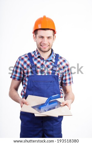 Portrait of an engineer and a workman holding a tile and a ceramic tile cutter Stock photo © photography33
