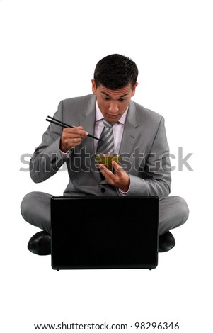 Surprised businessman eating Japanese food in front of his laptop Stock photo © photography33