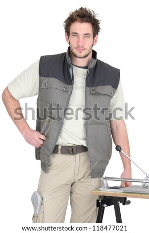Portrait of a tile fitter standing by a workbench and holding a mallet Stock photo © photography33