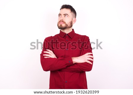 Thoughtful businessman with folded arms against white background stock photo © wavebreak_media