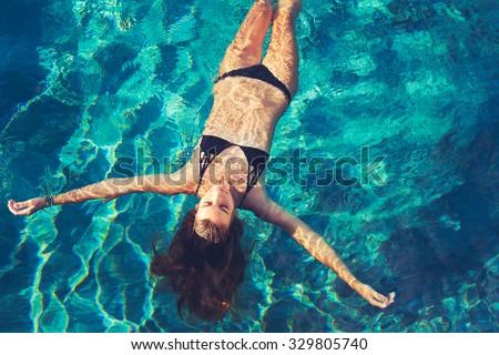Beautiful young woman enjoying swimming in refreshing sea water Stock photo © luckyraccoon