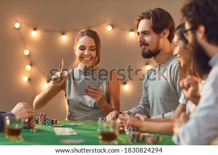 улыбаясь человека сидят таблице казино играет Сток-фото © wavebreak_media