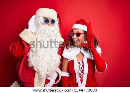 Сток-фото: Woman Wearing Santa Claus Hat And Sunglasses Listening To Music