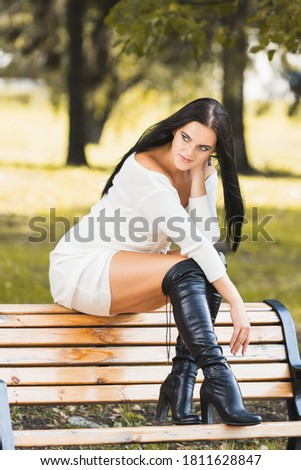 woman in long green dress sitting on a bench against lavender field stock photo © nejron