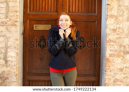 beautiful smiling middle aged redhead woman standing near car stock photo © nejron