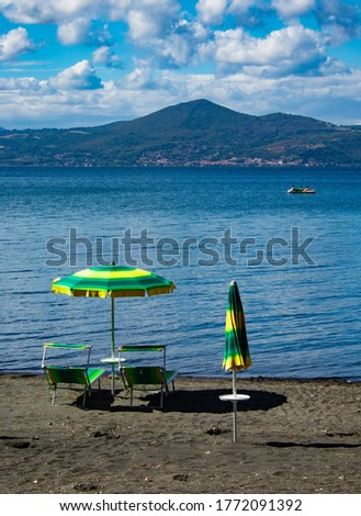 different parasols and sun loungers on the empty beach on tavira stock photo © capturelight