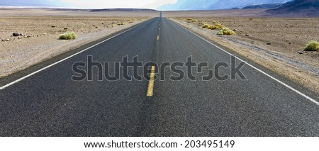 driving on the interstate 187 in death valley direction badwater in the heat of the mojave desert stock photo © meinzahn